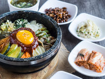 Korean rice mis with vegetables and egg with korean sauce. On wood background Royalty Free Stock Photo