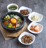 Korean rice mis with vegetables and egg with korean sauce. On wood background Royalty Free Stock Images