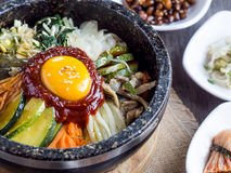 Korean rice mis with vegetables and egg with korean sauce. On wood background Stock Image