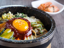Korean rice mis with vegetables and egg with korean sauce. On wood background Stock Photography