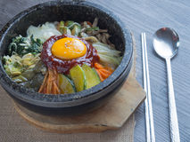 Korean rice mis with vegetables and egg with korean sauce. On wood background Stock Photo