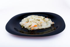 Korean rice noodles. On a dark plate Stock Images