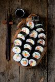 Korean roll Gimbapkimbob with ham, sausage, carrots, omelet, crab meat and rice. Royalty Free Stock Photo
