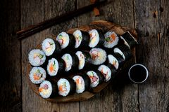 Korean roll Gimbapkimbob with ham, sausage, carrots, omelet, crab meat and rice. Royalty Free Stock Images