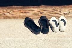 Korean rubber shoes. On stone floor Stock Photos