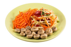 Korean salad on a green plate isolated on a white background Royalty Free Stock Photos