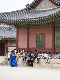 Korean School Trip. A class of students learning about Korean history at Gyeongbokgung palace in downtown Seoul Stock Images