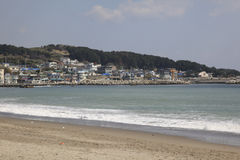 Korean Seashore town. Town on the edge of the water with a beach Royalty Free Stock Photography