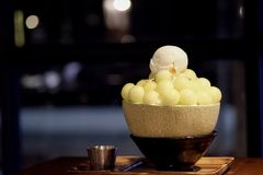Melon Bingsu on wood table. royalty free stock images