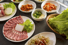Korean side dishes. A horizontal shot of beef with korean side dishes Royalty Free Stock Image
