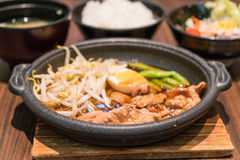 Korean spicy bbq pork served on a hot plate. With side dishes and rice stock photography