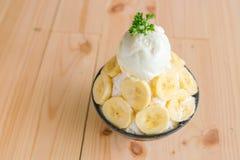 Korean style bing su fresh banana shaved ice on wood table . Stock Images
