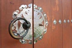 Korean style knocker. On wooden doors Stock Photo