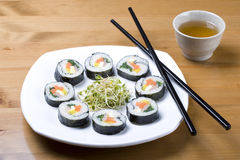 Korean style sushi and a cup of tea. Royalty Free Stock Image