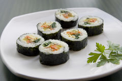 Korean sushi and a parsley leaf. Royalty Free Stock Photo