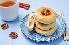 Korean sweet pancakes with nuts topping. Hotteok. Toning. selective focus Stock Photography