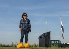 Korean tourist posing in big yellow clogs by the Schermerhorn Museum Mill and visitors center, Stompetoren, Netherlands. Pictured is a female Korean tourist royalty free stock image