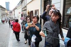 Korean tourists enyoing Kravata's day parade,Zagreb,1 Royalty Free Stock Image