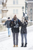 Korean tourists take pictures at the Charles Bridge royalty free stock photography