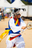 Korean Traditional Drum Man Spinning Tassle Hat. SEOUL, KOREA - SEPTEMBER 18, 2009: An unidentified Korean man dressed in traditional clothes dances and drums Royalty Free Stock Image