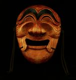 Korean traditional male wooden mask. On a black background Stock Photos