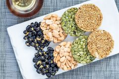 Korean traditional sweet snacks with peanuts, pumpkin seeds, black soybeans and chinese buckwheat. Top view, horizontal Royalty Free Stock Photography