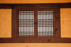 Korean traditional wooden window and brown wall