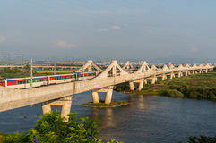 Korean train over the bridge and lake Royalty Free Stock Photography