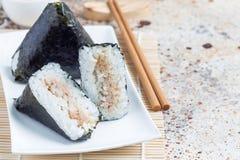 Korean triangle kimbap Samgak with nori, rice and tuna fish, similar to Japanese rice ball onigiri. Horizontal, copy space Royalty Free Stock Photo