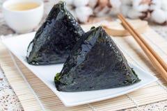 Korean triangle kimbap Samgak with nori, rice and tuna fish, similar to Japanese rice ball onigiri. Horizontal Stock Image