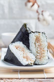 Korean triangle kimbap Samgak with nori, rice and tuna fish, similar to Japanese rice ball onigiri. Vertical, copy space Stock Images