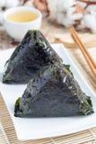 Korean triangle kimbap Samgak with nori, rice and tuna fish, similar to Japanese rice ball onigiri. Vertical Stock Photography