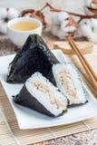 Korean triangle kimbap Samgak with nori, rice and tuna fish, similar to Japanese rice ball onigiri. Vertical Royalty Free Stock Photos