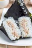Korean triangle kimbap Samgak with nori, rice and tuna fish, similar to Japanese rice ball onigiri. Vertical Royalty Free Stock Image