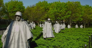 Korean War Monument, Washington, DC. Statues of soldiers in field at Korean War Monument on National Mall in Washington, DC stock video footage