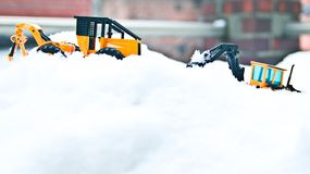 Korean winter, many white snow, icy roads, two large toy forklifts. Winter snow background, two generations of forklift Royalty Free Stock Photography