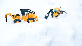 Korean winter, many white snow, icy roads, two large toy forklifts. Winter snow background, two generations of forklift Stock Photo