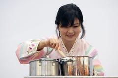 Korean woman cooking Stock Photo