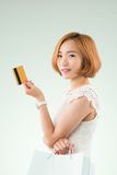 Korean woman with credit card Stock Photography