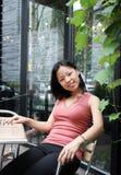 Korean woman in garden Stock Photo