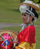 Korean Woman in Headdress with Drum at Cultural Celebration Stock Images