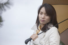 Korean woman lost in thought. Royalty Free Stock Photography