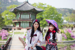Korean women wearing Hanbok at Gyeongbokgung Palace's Pavilion, Seoul South Korea Royalty Free Stock Images
