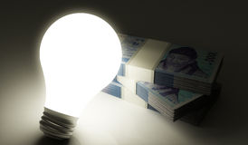 Korean won stack with lightbulb Royalty Free Stock Photography