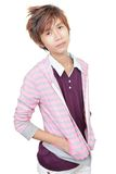 Korean young fashion model. Korean young male fashion model posing and standing in mauve-pink outfit. Isolated over white Royalty Free Stock Photo