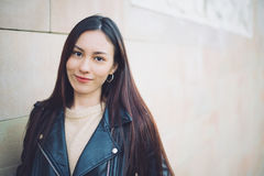 Korean young woman close-up looking at the camera smiling and ha Stock Photos
