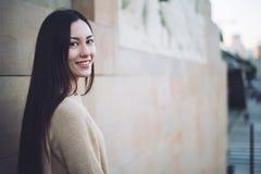 Korean young woman close-up looking at the camera smiling and ha Stock Photo