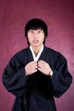 Koreanischer Mann in einem traditionellen Kleid Stockbild