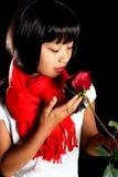 Koreanisches Mädchen mit einer Rose Lizenzfreies Stockbild