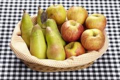 Korg av äpplen och päron Royaltyfria Bilder